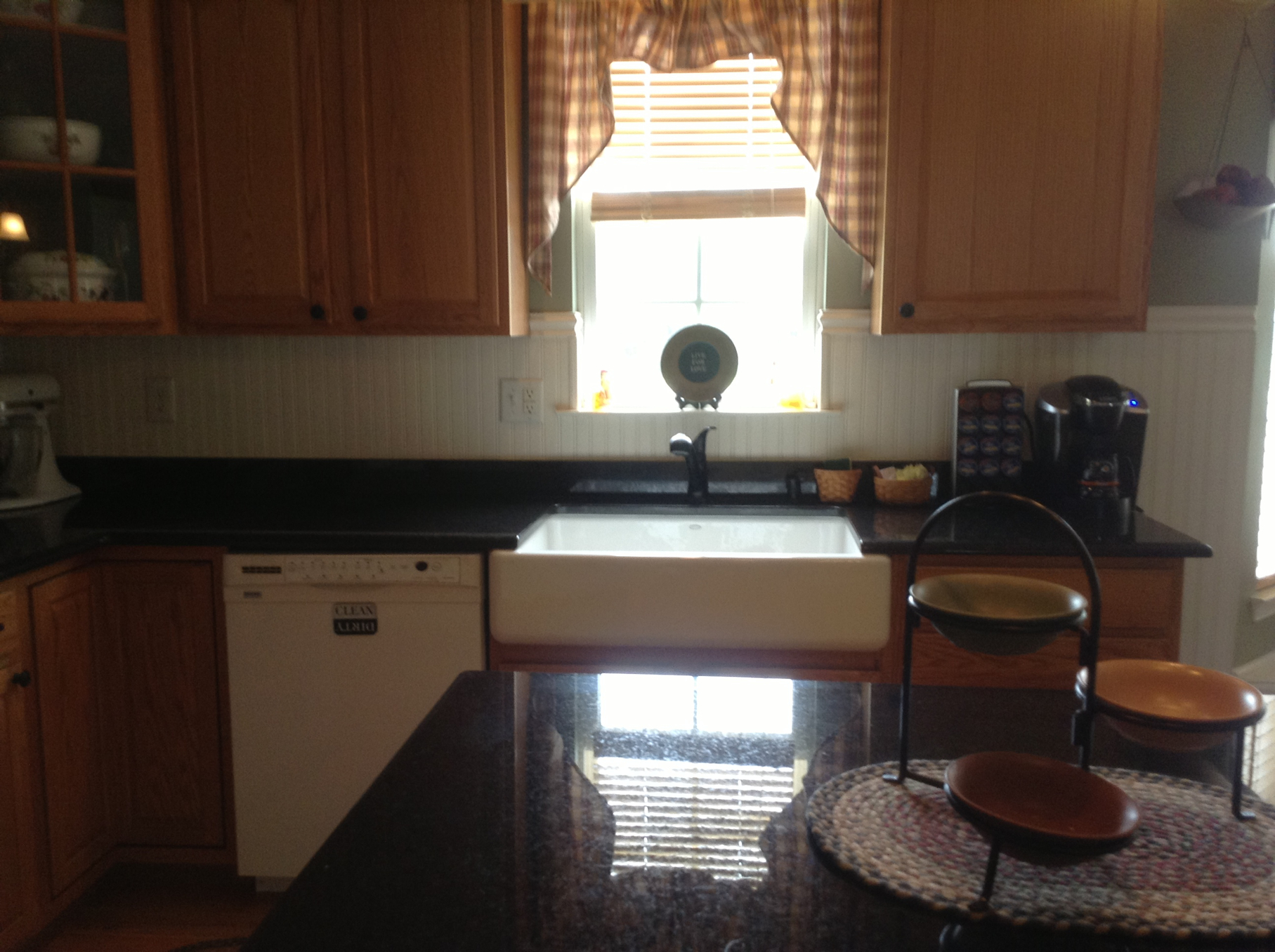 Granite & Marble Inc ? 3cm Black Pearl Kitchen with Farmhouse sink