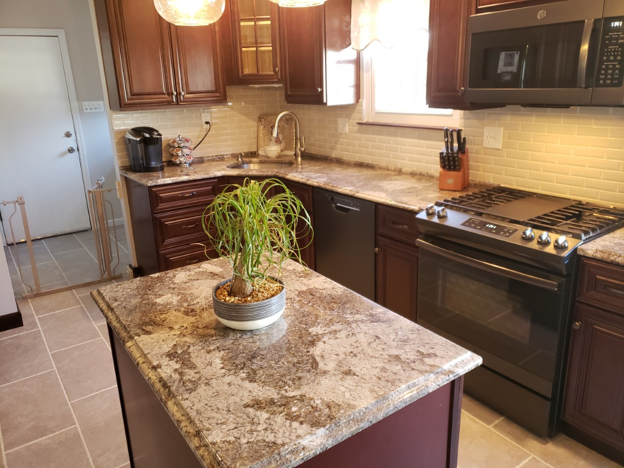 - Colossus Granite & Marble Inc. 3cm Normandy Granite Kitchen With 4